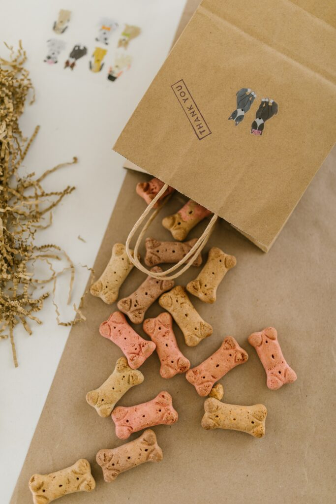 Dog treats coming out of a paper bag